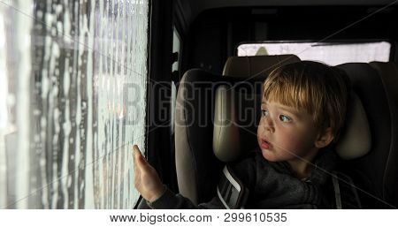Little Boy Looking Through Misted Window. Cleaning Car Using High Pressure Water. Car Wash, Car Wash