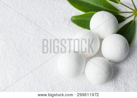 Handmade Salt Bath Bombs In Balls Shape From Organic Vegan Natural Ingredients On White Towel Green