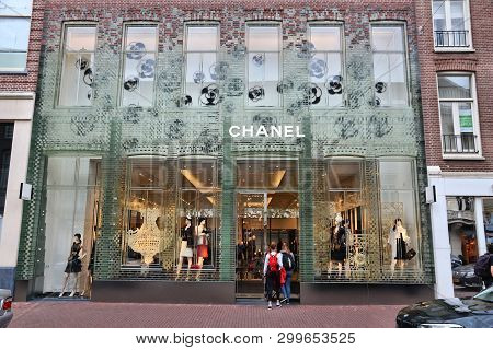 Amsterdam, Netherlands - July 10, 2017: Person Walks By Chanel Fashion Shop At P.c. Hooftstraat In A