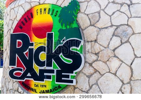 Negril, Jamaica - February 15, 2019: Sign At Brick Wall Entrance To Ricks Cafe, A Famous Sports Bar