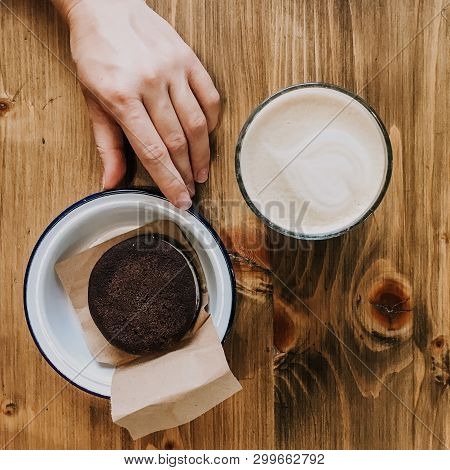 Cup Of Coffee And Chocolate Cake On Wooden Table. Hand Touching A Cake. Squred Photo Vintage Dish