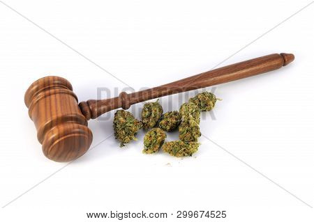 Conceptual Image Of Legalized Weed Laws Using Fresh Marijuana And A Wooden Gavel Isolated Over A Whi