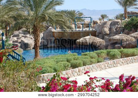 Egypt, Red Sea Resort, - Circa 2008 - Tourists Enjoy A Cool Dip In A Resort Pool On Egypts Red Sea.