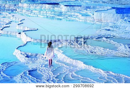 Girl Standing On Pool Of Pamukkale In Turkey
