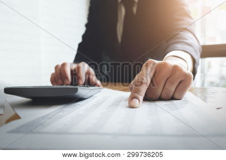 Business Accounting , Business Man Using Calculator With Calculate Stock Maket Data Chart, Tax And B