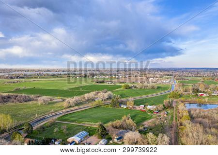 farmland with a major irrigation cannal at Colorado foothills near FOrt Collins, early spring aerial view