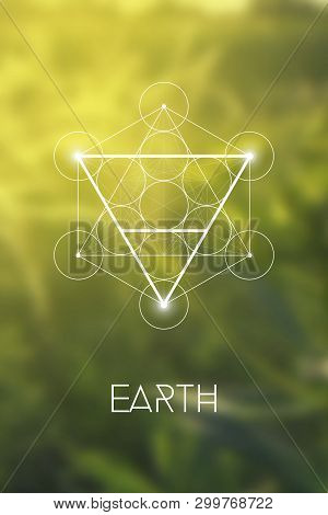 Sacred Geometry Earth Element Symbol Inside Metatron Cube And Flower Of Life In Front Of Natural Blu
