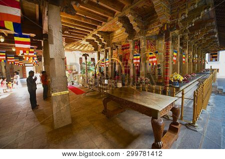 Kandy, Sri Lanka - May 21, 2011: Pilgrims Pray In The Temple Of The Tooth Relic, Famous Temple Housi