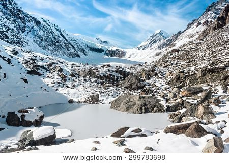 Top Of Mountain Under Snow And Blue Sky. Climbing The Rocks, Alipinism. Winter Panorama Of Altai Mou