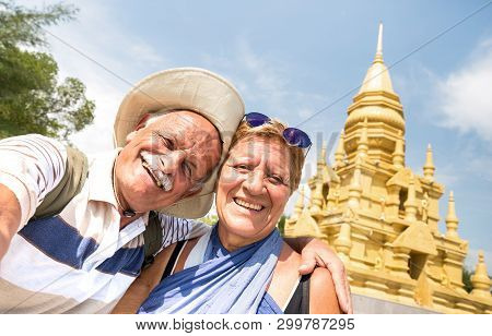 Senior Couple Taking Selfie At Golden Temple In Ko Samui - Happy Retired People Traveling To Thailan