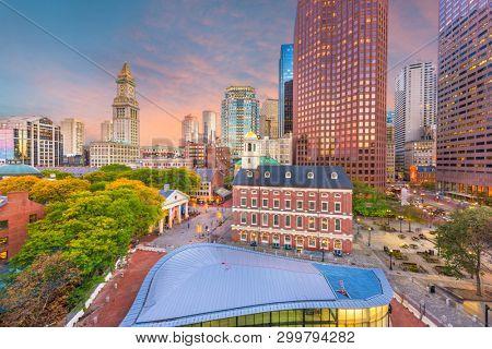 Boston, Massachusetts, USA downtown markets and cityscape at twilight.