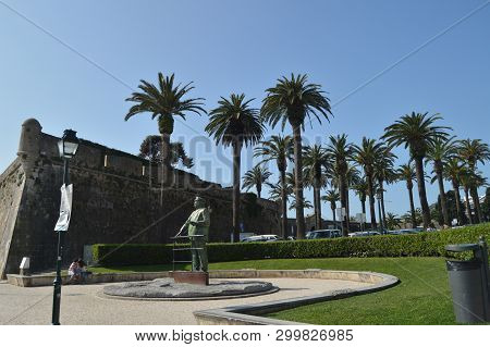 Statue Dedicated To King Charles And A Couple In Love Kissing Beside The Sculpture In Cascais. Photo