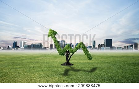 Green Plant In Shape Of Of Grow Up Trend At Field. Business Analytics And Statistics. Friendly Ecosy