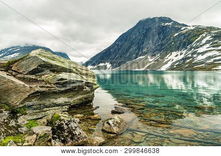 Lake Djupvatnet Near The Mountain Dalsnibba And The Geirangerfjord In Norway. Travel To Norway. Pano