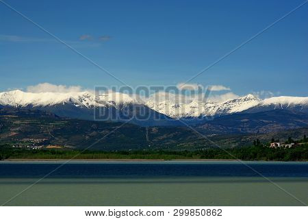 Tremp Reservoir; Snowy Pyrenees Mountains In The Background
