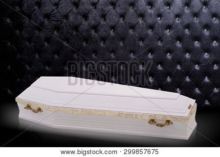Closed Wooden White Coffin Isolated On Gray Luxury Background. Casket, Coffin On Royal Background.