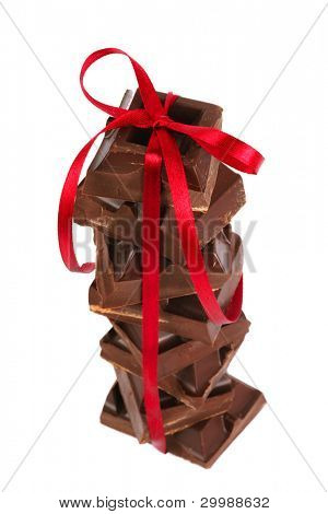 pyramid of chocolate with a satin ribbon on a white background