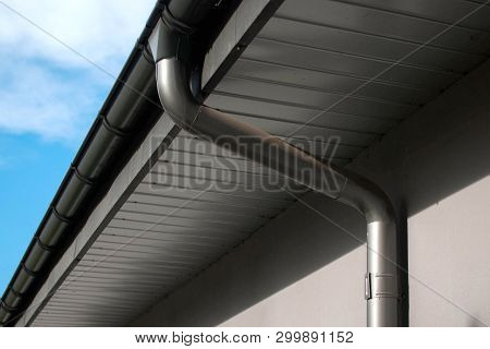 Lateral Coated Metal Panel, Coated Rain Gutter And Rain Water Pipe At A Roof, Covered With Metal Sha