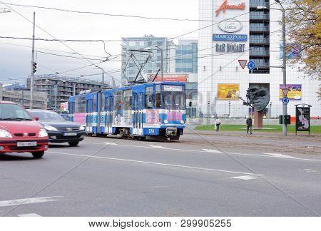 Tallinn, Estonia - October 26, 2006: Blue Articuated Public Transportation Tram In The Downtown Dist