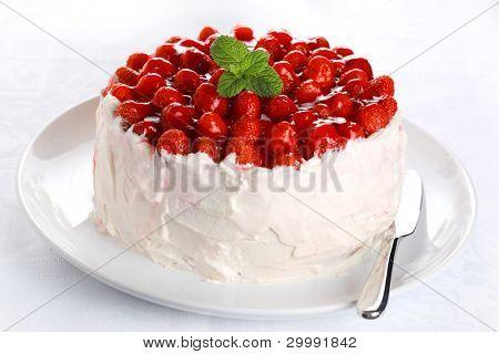 beautiful cake with strawberries and cream