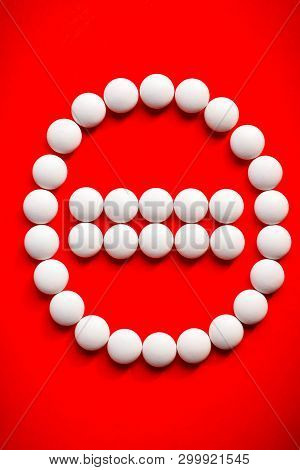 White Pills Arrange In Stop Sign. Film Coated Tablets Of Minerals, Anti Stress Formula On Red Backgr