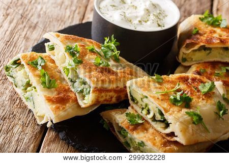 Afghan Fried Flat Breads With Potatoes, Green Onions And Cilantro Closeup. Horizontal