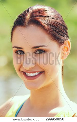 Portrait of young woman in summer or spring day, outdoor.