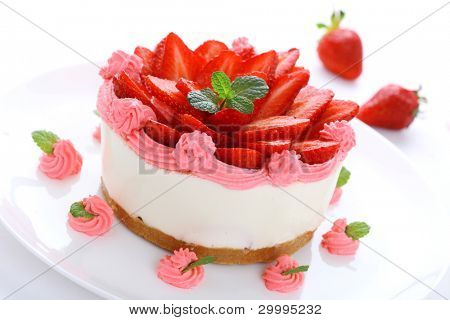 Cheesecake with fresh strawberries on white background