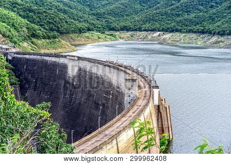 Large Concrete Dam. Reservoirs Created By Dams Suppress Floods, Activities Such As Irrigation And Hu