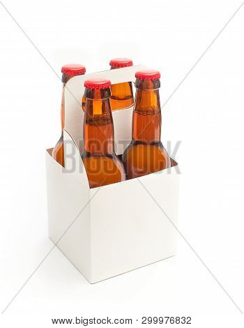 A White Blank Beer Packaging With Four Brown Beer Bottles Isolated On A White Background.