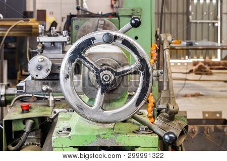 Front View Of A Crank Wheel On Industrial Lathe Machine In A Factory.