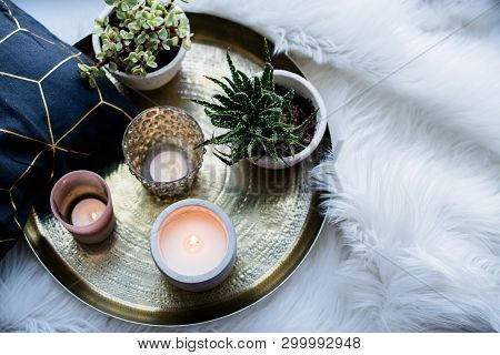 Cozy Real Home Decoration, Burning Candles On Golden Tray With Pillow On White Faux Fur On Windowsil