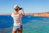 Tourist woman on sunny resort beach at the coast of Red Sea in Sharm el Sheikh, Sinai, Egypt, Asia in summer hot. ?oral reef and crystal clear water. Famous tourist destination diving and snorkeling poster
