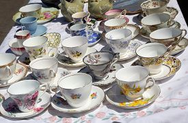 Display With Vintage Tea Cups With Saucers At Flea Market.