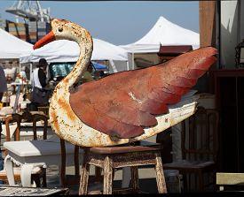 Display With Rusty Swan Decoration At Flea Market.