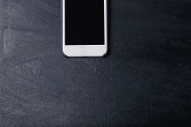 Smartphone With Screen On The Black Jeans Background.