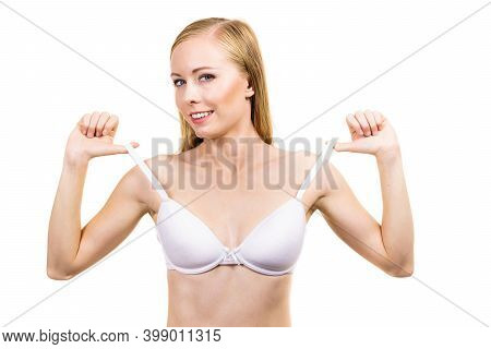 Smiling Woman Holding Bra Strap. Properly Bra Fitting. Female Breast In White Lingerie. Bosom And Un