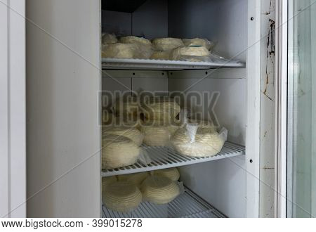 Nazareth, Israel, December 05, 2020 : Adyghe Cheeses Lie On A Shelf In The Refrigerator Of A Store I
