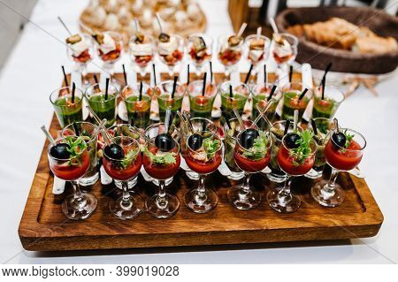 Plate On The Table With Gourmet Variety Of Mini Appetizers With Different Toppings. Assorted Italian