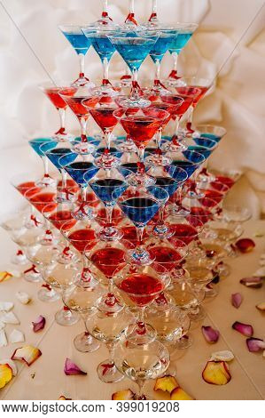 Pyramid Of Glasses With Martini Cocktail For A Festive Reception At The Wedding On The Table. Cosmop