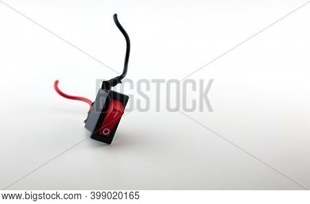 Power down, shutdown concept image. Red switch falling down, red black and white cable legs. Switch in