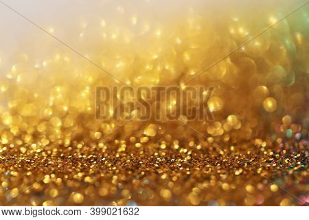 Gold Glitter Glow Background. Gold Shiny Texture.new Year And Christmas Background.wallpaper Phone G