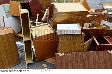 Old Broken Wooden Furniture On Waste Dump Site For Recycling, High Angle View