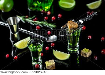 Alcohol, Luxurious Spirits And Dangerous Liquor Absinthe, Pouring On Stainless Steel Spoon, Brown Su
