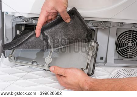 Dust And Dirt Trapped By The Clothes Dryer Filter, Men Cleaning After Using.