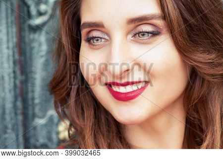Portrait Of Beautiful Young Woman Outdoor Over Old Door.