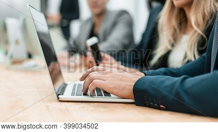 Close Up. Casual Businessman Typing On Laptop