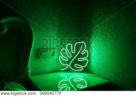 Neon Sign Monstera In The Decor Of The Bedroom. Trendy Style. Neon Sign. Custom Neon. Home Decor.