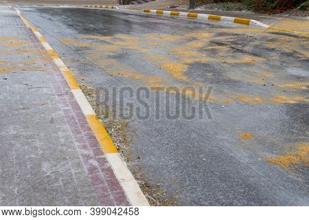 Ice On The Road Is Sprinkled With Sand And Salt For The Safe Movement Of Pedestrians And Cars.