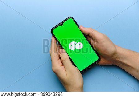Wechat Messenger Logo On Mobile Phone Screen. Russia, St.petersburg, 8 December 2020.